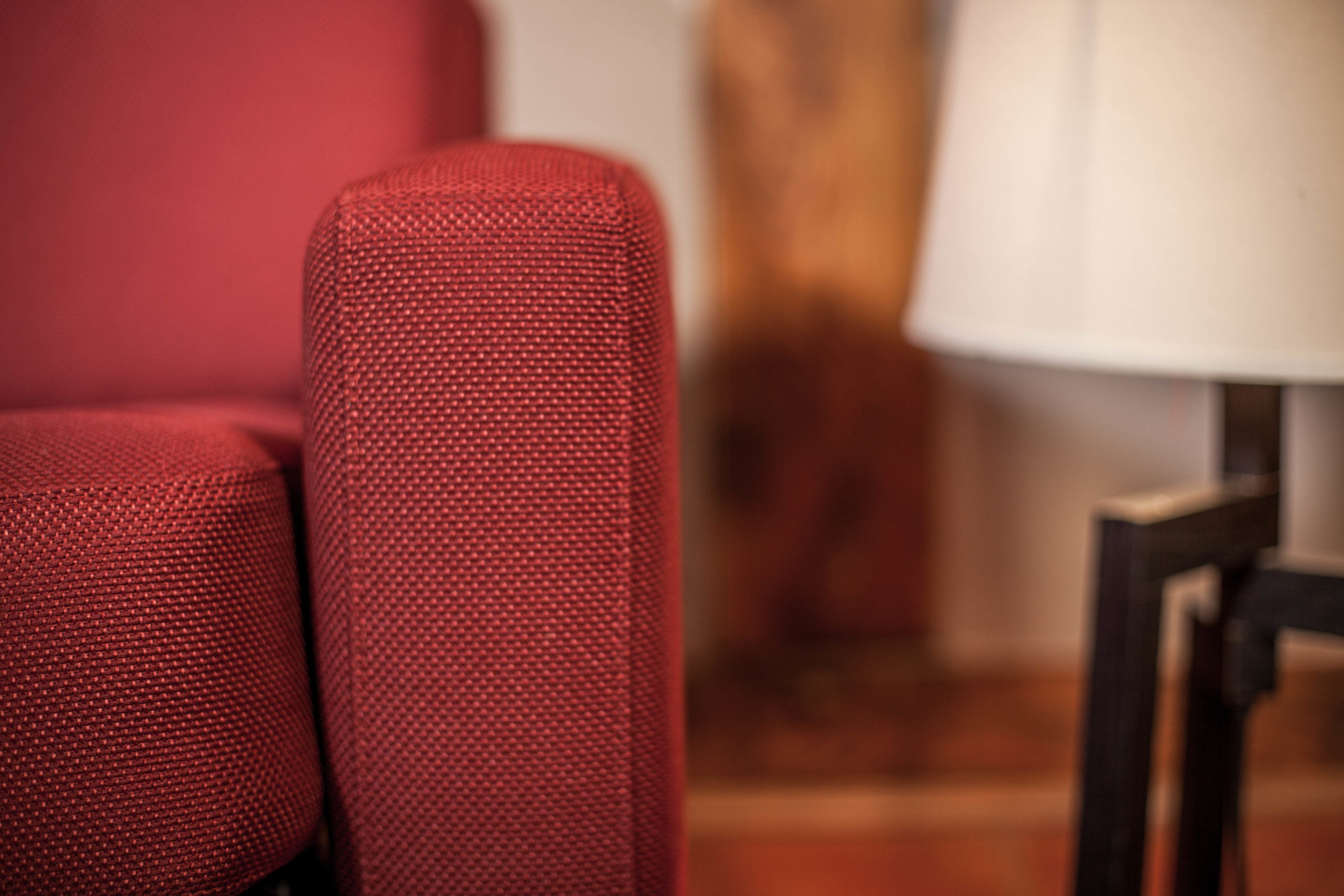 red armrest of the hotel sofa bed